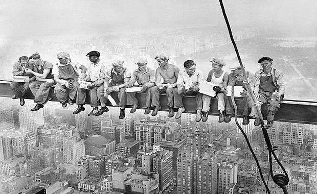 "It's a grainy black and white picture that you might have seen before, 13 men sitting on a steel beam, eating lunch with their legs dangling above a 1930's New York skyline at a stomach churning height.   And until recently, the famous picture, sometimes referred to as the ""Men on the Beam"" picture, was shrouded in a mystery of sorts -- the name of the photographer was never known, or often misattributed. It turns out that a photographer with a colorful past as an one-time actor, auto racer, wrestler, hunter, fisherman and pilot by the name of Charles Ebbets shot the picture in 1932 after he was hired to chronicle the Rockefeller Center's construction during the Depression era.    REUTERS/Bettman/CORBIS"